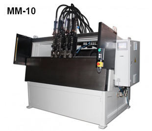 ReivaxMaquinas SL: MM-10 Machine for manufacturing frames or similar pieces.